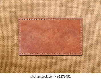 blank leather label stitched onto the canvas