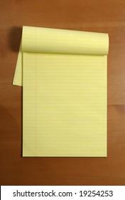 A blank legal pad on an office desk