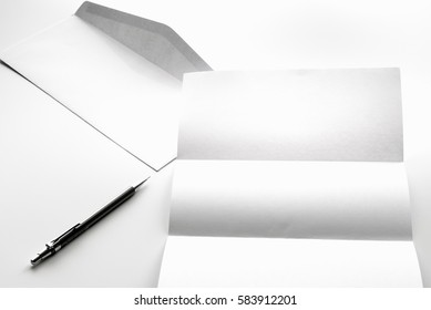 blank of letter paper and white envelope with pen Isolated on white background