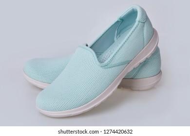 Blank light blue slip-on shoes on a white background. Plain hipster slipons. Urban skate shoes. Casual summer footwear. Loafer, slip-on, sneaker