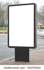 Blank lightbox billboard beside the road. Background for mockup. Outdoor advertising