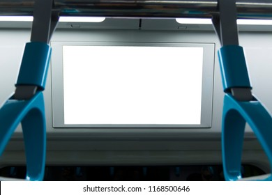 A blank lighted signboard inside a high speed train, with space for text.