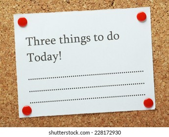 A blank list of Three Things to do Today! pinned to a cork notice board. A short list of objectives often motivates us to get things done.