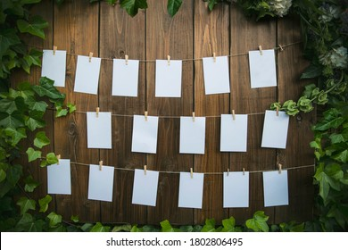 Blank list of wedding guests on a wooden background and decorated with flowers