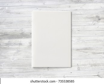 Blank Magazine or Brochure on wooden background. Front cover top view. Mockup template to your design.