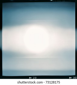 Blank medium format (6x6) color film frame with abstract filling containing light leak in center, kind of a background