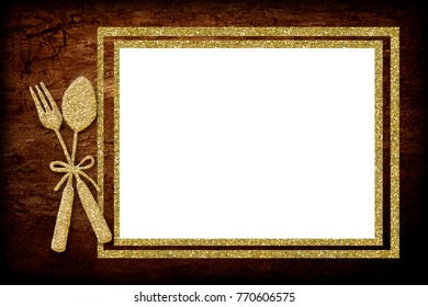 A blank menu board with golden spoon and fork.