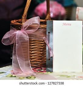 Blank menu card near a wedding basket, creating beautiful wedding table set