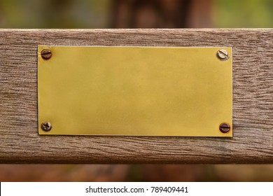 blank metal plate on wooden surface