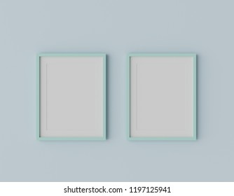Blank mint green color picture frame template for place image or text inside on the light blue wall. pastel concept.