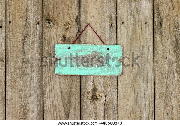 Blank mint green wooden sign hanging on antique rustic wood background