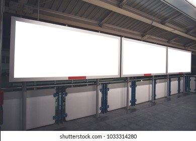 Blank mock up banner media light box at sky train station. Isolated clipping path included.