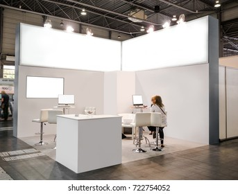 Blank mock up creative exhibition stand design with shapes. Booth template, Empty exhibition kiosk, with copy space, futuristic interior suspending lighting fixtures, computer and tv screen.