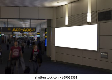 Blank mock up of horizontal street poster billboard on Airport Background with plane passengers.
