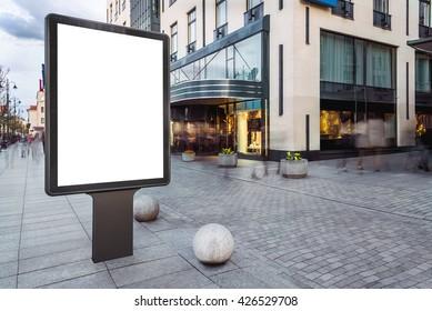 Blank mock up of vertical street ad billboard in busy city street