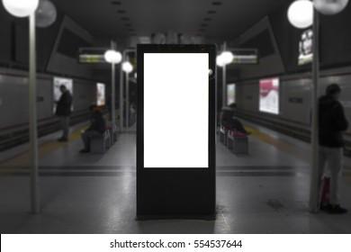 Blank mock up of vertical street poster billboard on Izmir Public Train Station. Blur background