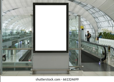 Blank mock up of vertical street poster billboard on Airport Background with plane passengers.