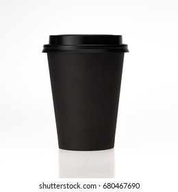 blank mockup for desigh  black paper with black plastic cap coffee cup for take away  isolated on white background