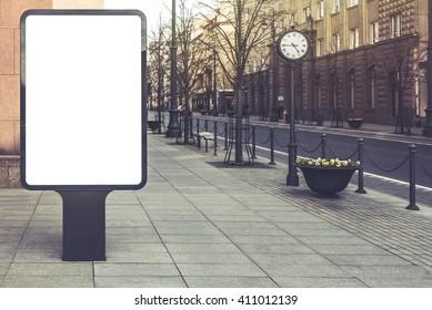 Blank mockup of  vertical advertising street billboard on city background. Vintage effect filter style