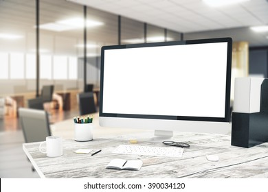 Blank monitor on wooden desktop with blurry office in the background, mock up, 3D Render