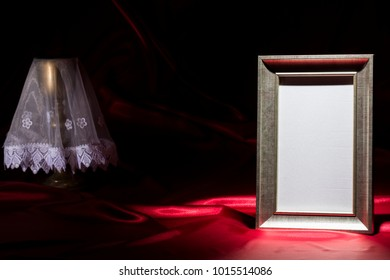 blank mourning frame, with goldene chalice on deep red background