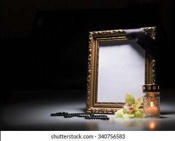 Blank mourning frame for sympathy card on dark background