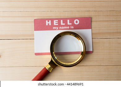 Blank name tag with magnifier glass