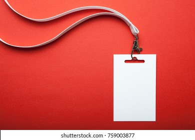 Blank name tag, with white lanyard on red. Name tag is blank for your text. Mock up.