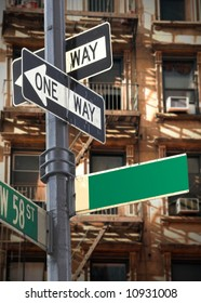 Blank New York street sign in front of apartment buildings