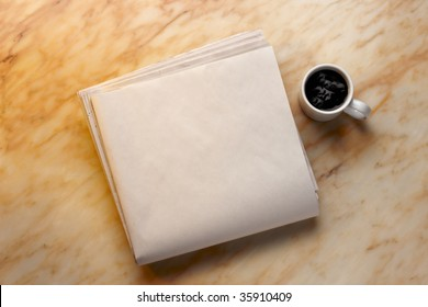 Blank newspaper and cup of coffee on marble surface. Add your own copy.