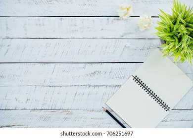 Blank note book  for leave a message memo on white wooden background with copy space.