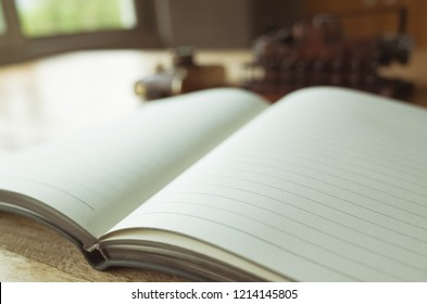 blank note book with typewriter on the desk at home