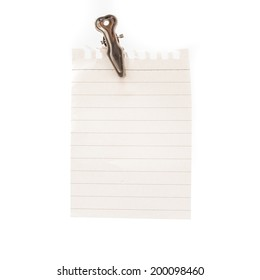 blank note and a clothes peg on white background