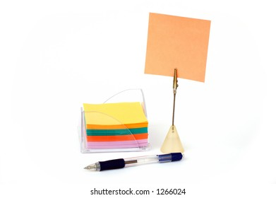 Blank note on stand with stack of notes in holder and pen -look in profile for more