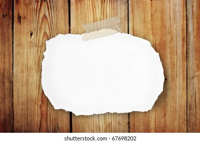 blank note paper attach on old wooden background
