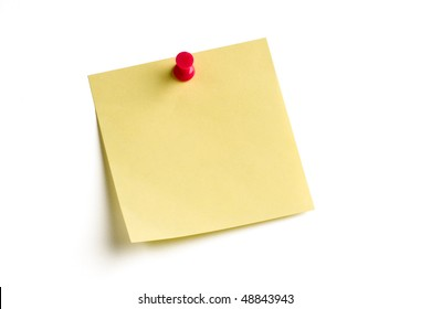 Blank note pinned on white board with soft shadow.