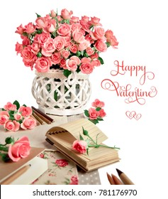 Blank notebook among beautiful pink roses, isolated on white. Space for your note on the page, space for your textt. Design for an Anniversary, Mothers day or St. Valentine. Iimage is toned.