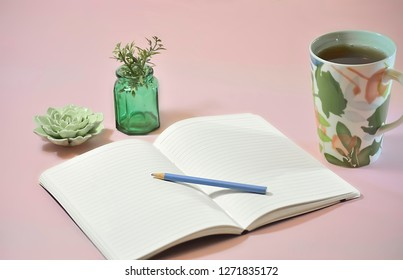 Blank Notebook with Coffee and Plants on Pink Background