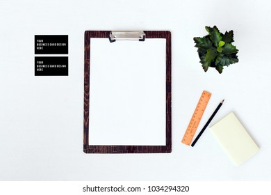 blank notebook with computer, smart phone, coffee and vintage camera on white wood background, business concept