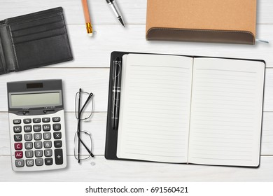 blank notebook or diary and pocket card with calculator and eyeglasses for stationery on top view white wood table or desk for your note or put card in the wallet