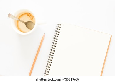 Blank notebook and drunk coffee cup  on white background.
