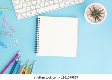 Blank notebook with keyboard and pencil on blue background,Flat lay photo of notebook for your message