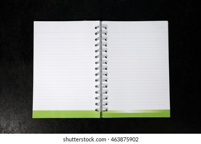 Blank notebook on black wood floor