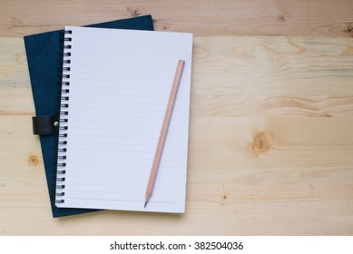 blank notebook on desk background.
