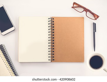 blank notebook on white table top view