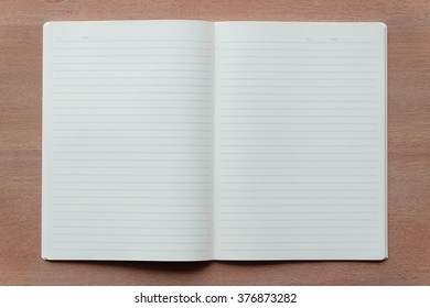 blank notebook on wood textures