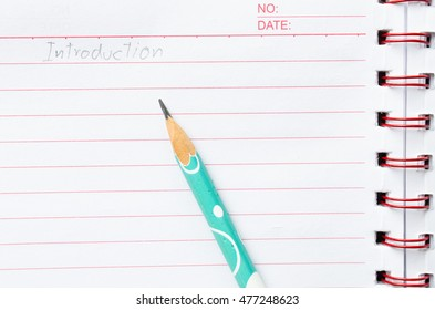 "blank notebook page with pencil and wording ""Introduction"""