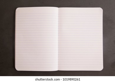 Blank Notebook Paper on a Chalkboard Background
