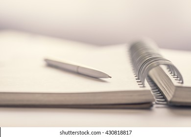 Blank notebook with pen on the office desk.Close up.
