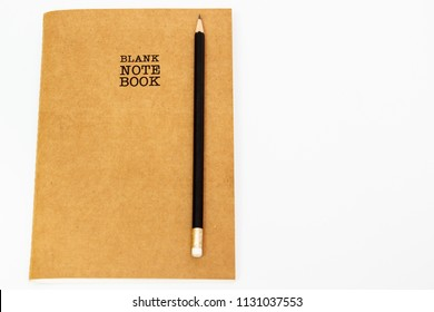 Blank notebook with a pencil close op on white background.